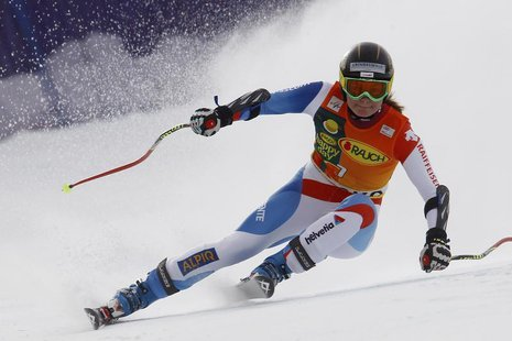 Martina Schild of Switzerland clears a gate during the women's Alpine Skiing World Cup Super G race in Bansko February 26, 2012. REUTERS/Dom