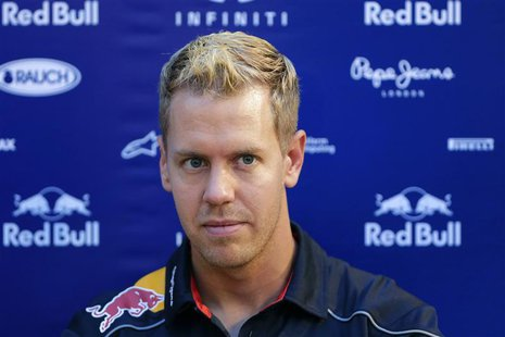 Red Bull Formula One driver Sebastian Vettel of Germany listens to a question during a news conference at the paddock ahead of the Singapore