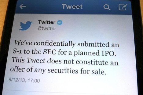 A tweet from Twitter Inc. announcing its initial public offering is shown in this photo illustration in Toronto, September 12, 2013. REUTERS