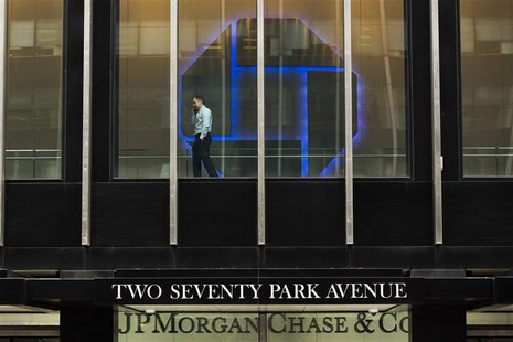 A man talks on his phone while pacing inside of the headquarters of JPMorgan Chase & Co bank in New York, March 15, 2013. REUTERS/Lucas Jack