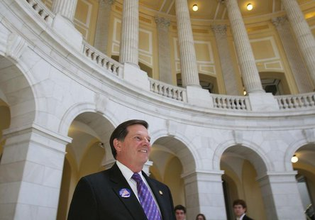 Former House Majority leader U.S. Representative Tom Delay (R-TX) walks out of the Cannon House Office Building on Capitol Hill on the day h