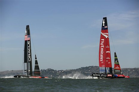 Emirates Team New Zealand (R) sails ahead of Oracle Team USA during Race 12 of the 34th America's Cup yacht sailing race in San Francisco, C