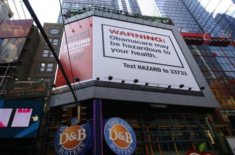 "A billboard on West 42nd Street between 7th and 8th Avenues advertising the defunding of ""Obamacare"" the Affordable Care Act (ACA), paid for"