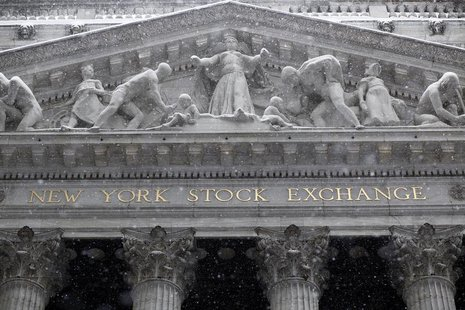 Snow falls outside the New York Stock Exchange during a winter storm in New York February 26, 2010. REUTERS/Chip East