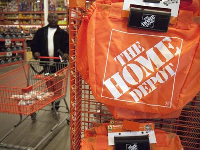 A customer wheels a cart through a Home Depot store in Washington February 20, 2012. REUTERS/Jonathan Ernst