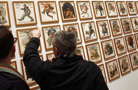 Visitors view a wall of Saturday Evening Post magazine covers featuring the art of Norman Rockwell at the Dulwich Picture Gallery in London