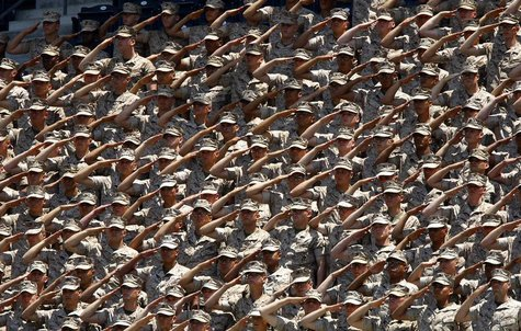United States Marines salute from the stands during the American National Anthem prior to the start of the San Diego Padres vs the New York