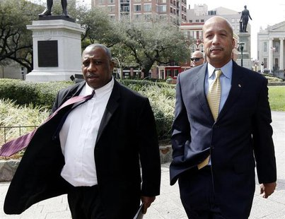 Former New Orleans Mayor Ray Nagin (R) and his attorney Robert Jenkins arrive at court in New Orleans February 20, 2013. REUTERS/Jonathan Ba