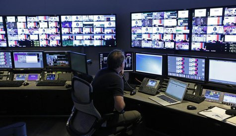 "A technician works in the ""Acquisition Room"", which receives televison feeds from around the world, during an event to mark the opening of t"