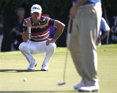 Billy Horschel of U.S. lines up his putt on the 18th green during the first round of the Tour Championship golf tournament at East Lake Golf
