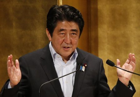 Japan's Prime Minister Shinzo Abe gestures as he delivers a speech at a seminar in Tokyo June 5, 2013. REUTERS/Toru Hanai