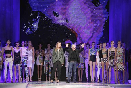 Italian designer Roberto Cavalli acknowledges the audience at the end of the Just Cavalli Spring/Summer 2014 collection during Milan Fashion