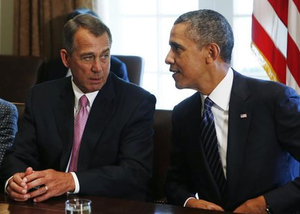 Speaker of the House John Boehner (R-OH) (L) talks to U.S. President Barack Obama during a meeting with bipartisan Congressional leaders in