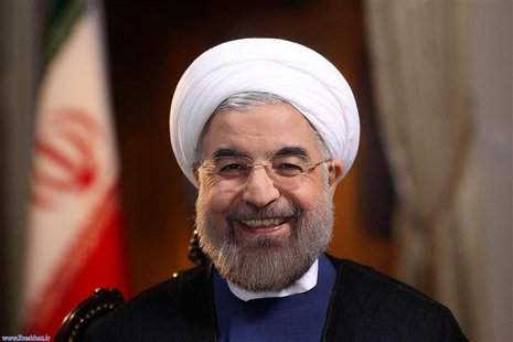 Iranian President Hassan Rouhani smiles during an interview with Ann Curry from the U.S. television network NBC in Tehran, in this picture t