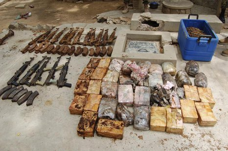 Ammunition and explosives seized from suspected members of Hezbollah are displayed after a raid of a building in Nigeria's northern city of