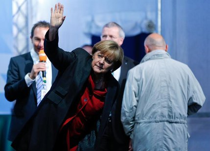 German Chancellor Angela Merkel arrives for a Christian Democratic Union election campaign meeting in Augsburg September 19, 2013. REUTERS/M