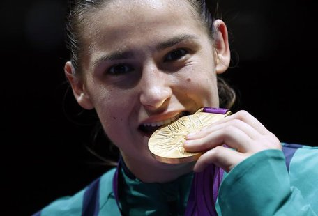 Katie Taylor of Ireland bites her gold medal following the presentation ceremony for the Women's Light (60kg) boxing competition at the Lond