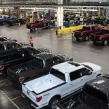 2014 Ford F-150 pick-up trucks are seen inside the plant at the Ford Motor Dearborn Truck Plant in Dearborn, Michigan September 16, 2013. Pi
