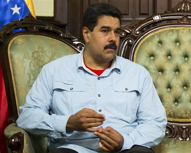 Venezuela's President Nicolas Maduro attends a meeting with South Africa's Foreign Minister Maite Nkoana-Mashabane in Caracas September 19,