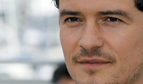 "Cast member Orlando Bloom poses during a photocall for the film ""Zulu"" at the 66th Cannes Film Festival in Cannes May 26, 2013. REUTERS/Regi"
