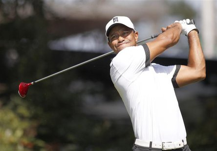 Tiger Woods of the U.S. drives off the fourth tee during round two of the Tour Championship golf tournament at East Lake Golf Club in Atlant