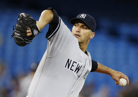 New York Yankees Andy Pettitte pitches to the Toronto Blue Jays during the first inning of their MLB American League baseball game in Toront
