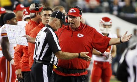 Kansas City Chiefs head coach Andy Reid (R) argues a call with an official during their NFL football game with the Philadelphia Eagles in Philadelphia, Pennsylvania, September 19, 2013. Kansas City won 26-16. Credit: Reuters/Tom Mihalek