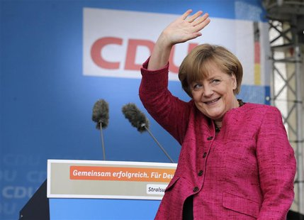 German Chancellor and conservative Christian Democratic Union (CDU) leader Angela Merkel waves to supporters during a CDU election campaign