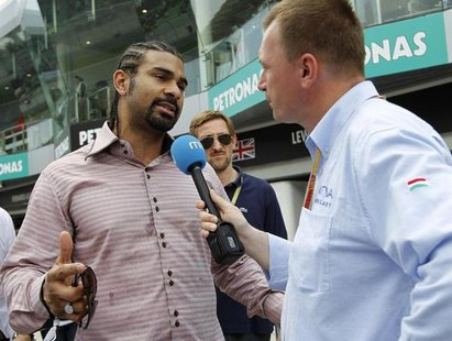 Former proffesional boxer David Haye of Britain talks to the media in the pit lane of the Sepang International Circuit outside Kuala Lumpur
