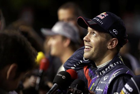 Red Bull Formula One driver Sebastian Vettel of Germany reacts during an interview after the qualifying session of the Singapore F1 Grand Pr