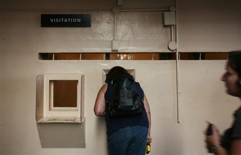 Visitors view the visitation area at Alcatraz Island in San Francisco Bay in San Francisco, California, August 9, 2009. REUTERS/Robert Galbr