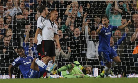 Chelsea's John Obi Mikel (L) celebrates scoring his goal against Fulham with Branislav Ivanovic (R) during their English Premier League socc
