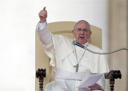 Pope Francis gestures as he leads his Wednesday general audience in Saint Peter's Square at the Vatican in this September 11, 2013 file phot