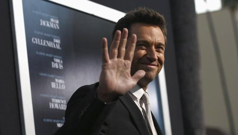 "Cast member Hugh Jackman waves at the premiere of his film ""Prisoners"" at the Academy of Motion Picture Arts and Sciences in Beverly Hills,"