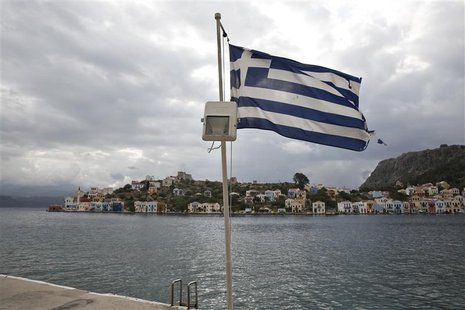 A Greek flag flutters at the port of the Greek southeastern island of Kastelorizo April 15, 2013. Picture taken April 15, 2013. REUTERS/Yorg
