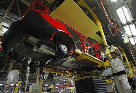 An employee works at an assembly line in AutoAlliance Thailand, a Ford and Mazda joint venture plant, located in Rayong province, east of Ba
