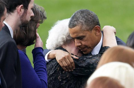 U.S. President Barack Obama hugs a family member of a victim slain in the Washington Navy Yard shooting during a memorial service in Washing