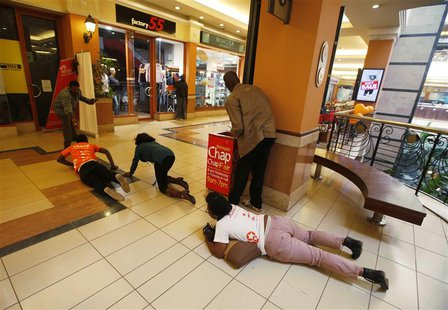 People scramble for safety as armed police hunt gunmen who went on a shooting spree at Westgate shopping centre in Nairobi, September 21, 20