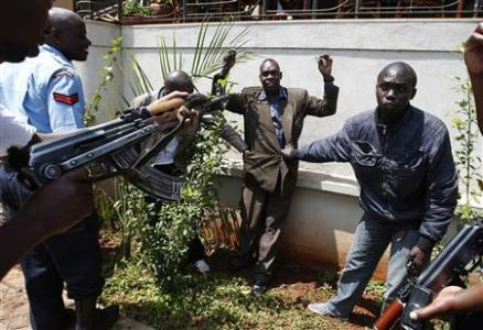 Policemen search a man for weapons as he walked out of Westgate Shopping Centre in Nairobi September 21, 2013. (Credit: Reuters/Goran Tomasevic)