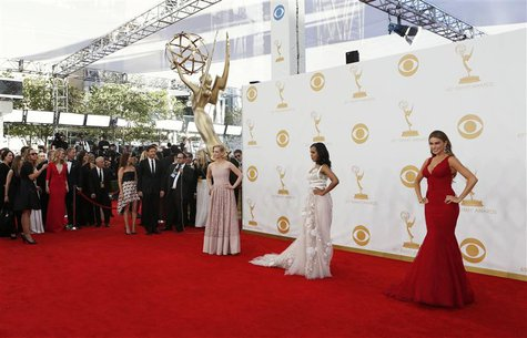 Actors January Jones (L), Kerry Washington (C) and Sofia Vergara arrive at the 65th Primetime Emmy Awards in Los Angeles September 22, 2013.