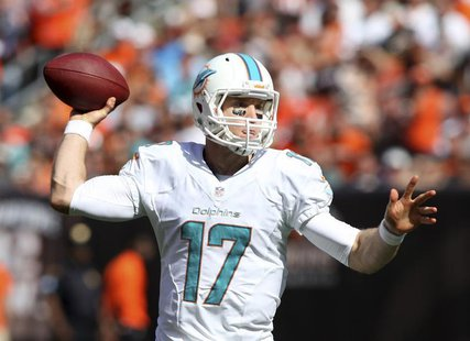 Miami Dolphins quarterback Ryan Tannehill throws a pass during the fourth quarter of their NFL football game against the Cleveland Browns in