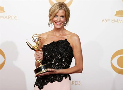 "Actress Anna Gunn from AMC's series 'Breaking Bad"" poses backstage with her award for Outstanding Supporting Actress In A Drama Series at th"