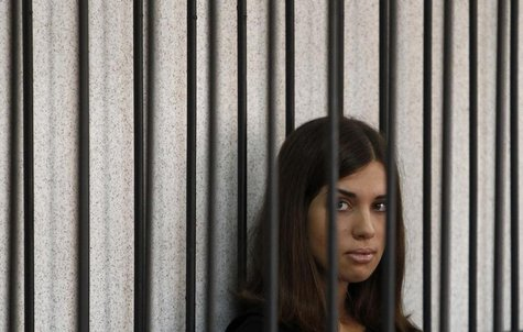 "Member of the female punk band ""Pussy Riot"" Nadezhda Tolokonnikova looks out from a holding cell as she attends a court hearing to appeal fo"