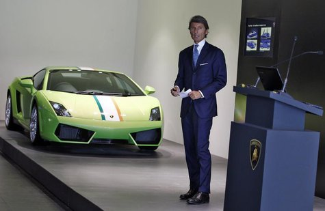 Stephan Winkelmann, CEO of Lamborghini, speaks with the media next to a Lamborghini Gallardo LP 550 during an opening ceremony of a new deal