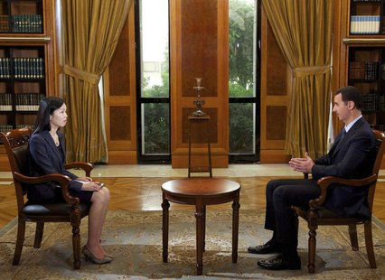 Syria's President Bashar al-Assad speaks during an interview with China's state television CCTV, in Damascus, in this handout photograph dis