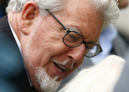 Entertainer Rolf Harris arrives at Westminster Magistrates Court, to face sex offence charges, in central London September 23, 2013. REUTERS