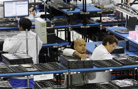"Workers assemble Motorola phones at the Flextronics plant that will be building the new Motorola smart phone ""MotoX"" in Fort Worth, Texas Se"