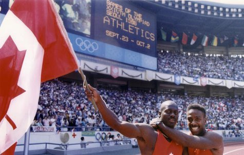 Ben Johnson of Canada (L) celebrates with team mate Desai Williams after winning the men's 100 meters sprint final at the Olympics in Seoul