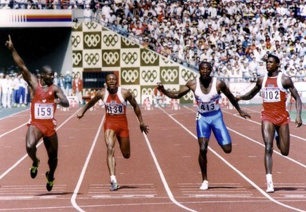 Ben Johnson of Canada (L) leads Calvin Smith of the U.S. (2nd L), Linford Christie of Britain (2nd R) and Carl Lewis of the U.S. (R) across