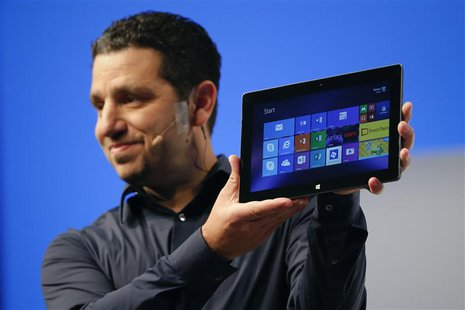 Panos Panay, Microsoft Surface general manager, holds up the Microsoft Surface Pro 2 during the launch of their Surface 2 tablets in New Yor